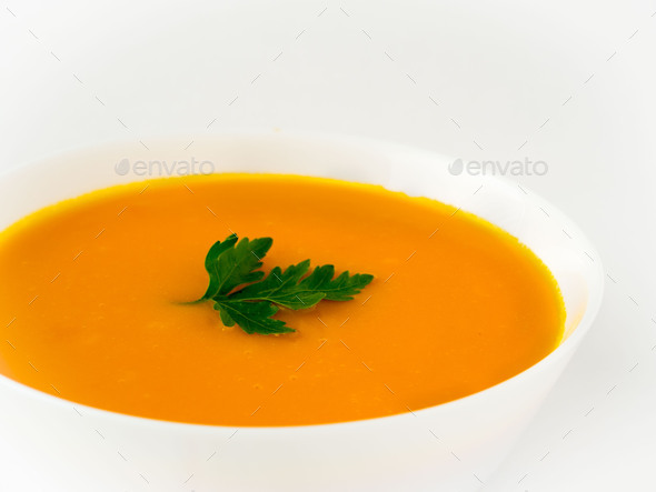 white bowl of pumpkin soup - Stock Photo - Images