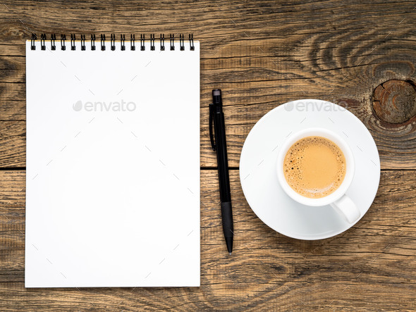 open notepad with spiral, pen and coffee cup - Stock Photo - Images