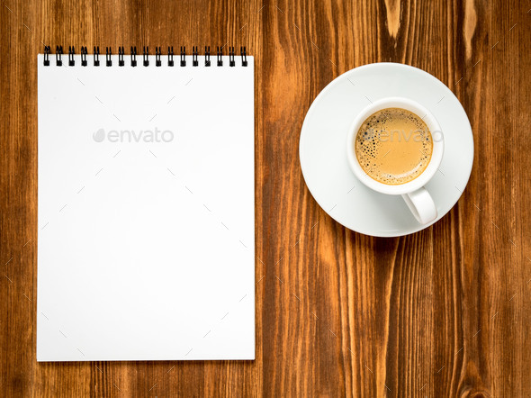 coffee in white cup and open notepad - Stock Photo - Images
