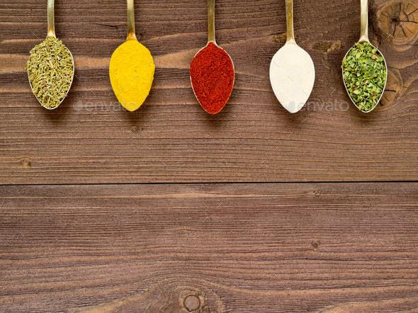 Milled spices - garlic, turmeric, paprika, rosemary, oregano - Stock Photo - Images