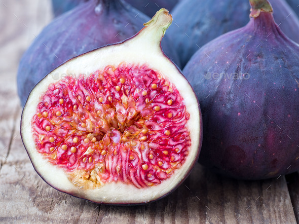 fresh Fig and cut off half - Stock Photo - Images