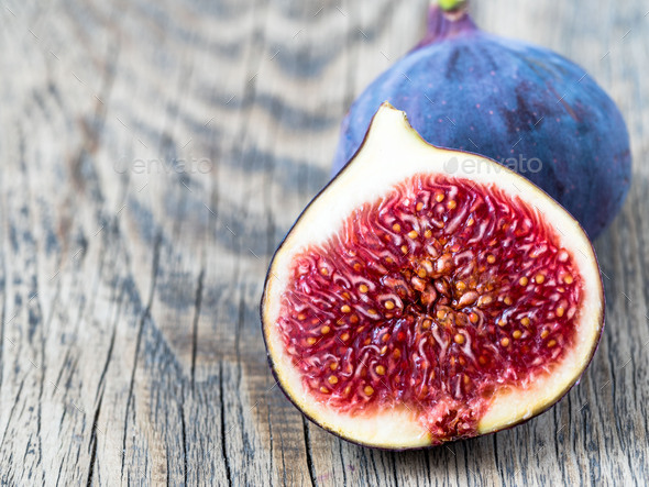 a fresh Fig and cut off half - Stock Photo - Images