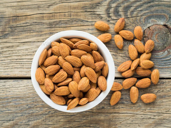 white bowl with a handful of nuts - Stock Photo - Images