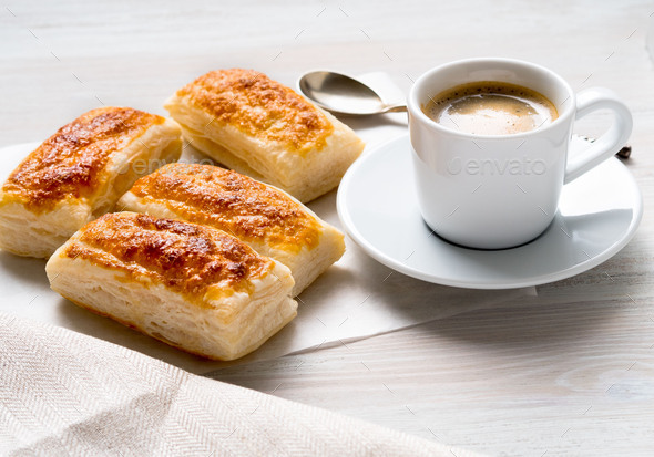 morning Breakfast with fresh rolls of puff pastry and Cup of coffee on white wooden table. - Stock Photo - Images