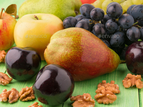 set of fruits on a green wooden table - Stock Photo - Images