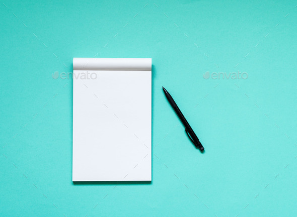 open notepad with a clean white page - Stock Photo - Images