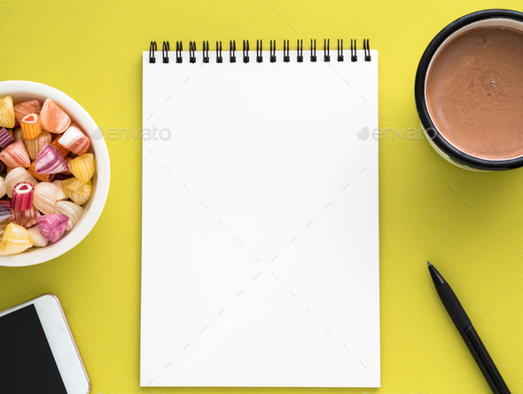Open notepad on spiral with clean white page - Stock Photo - Images