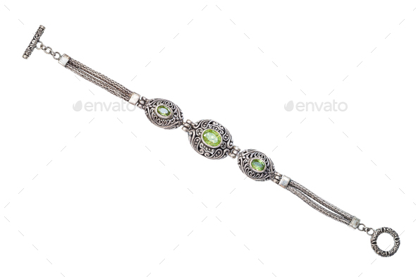 silver bracelet with natural peridot gemstones - Stock Photo - Images
