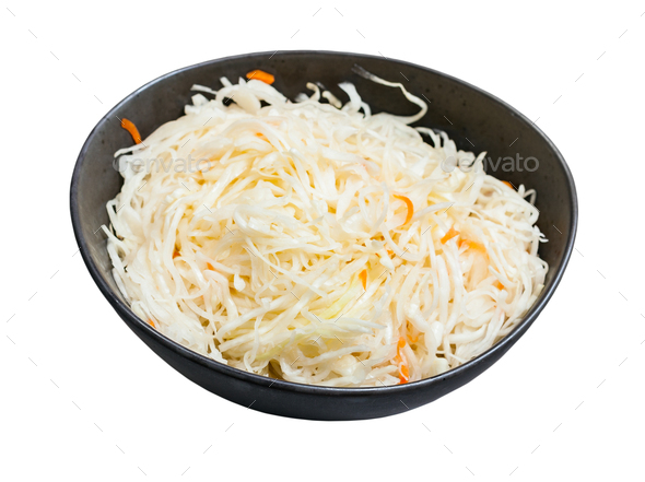 Russian sauerkraut in bowl isolated on white - Stock Photo - Images