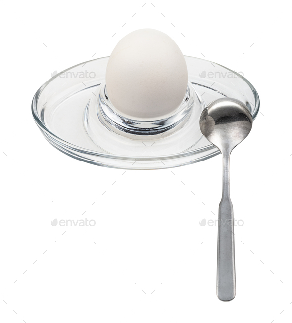 whole boiled white egg and spoon in glass egg cup - Stock Photo - Images