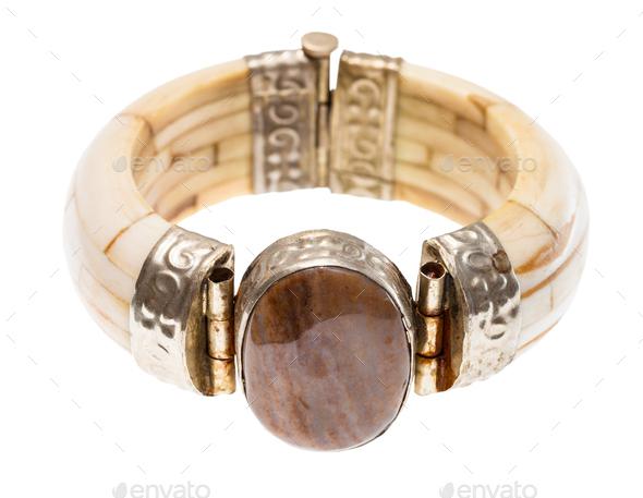 travertine stone insert in camel bone bracelet - Stock Photo - Images