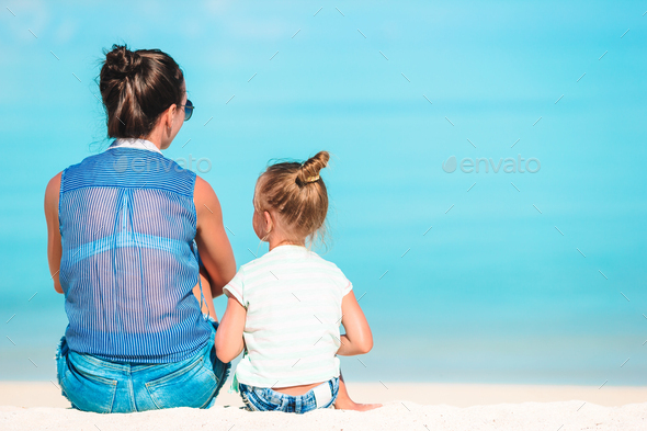 Beautiful mother and daughter on Caribbean beach - Stock Photo - Images