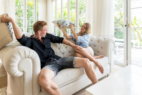 Couple relaxing together on sofa - Stock Photo - Images