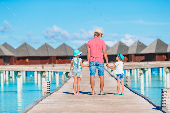 Father and kids enjoying beach summer vacation - Stock Photo - Images