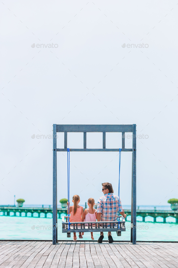 Happy beautiful family of dad and kids on white beach - Stock Photo - Images