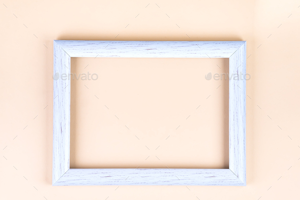 Distressed white painted picture frame, isolated on beige, copy space - Stock Photo - Images