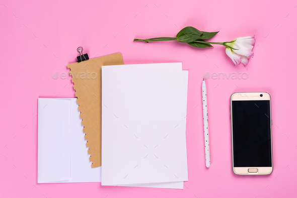 Flowers composition. Paper blank, phone and notebook with eustoma pink flowers on pink background - Stock Photo - Images