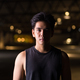 Portrait of young handsome Asian man outdoors at night - PhotoDune Item for Sale