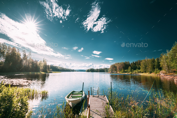 Old Wooden Fishing Boat Moored Near Pier In Summer Lake Or River. Beautiful Summer Sunny Day Or - Stock Photo - Images