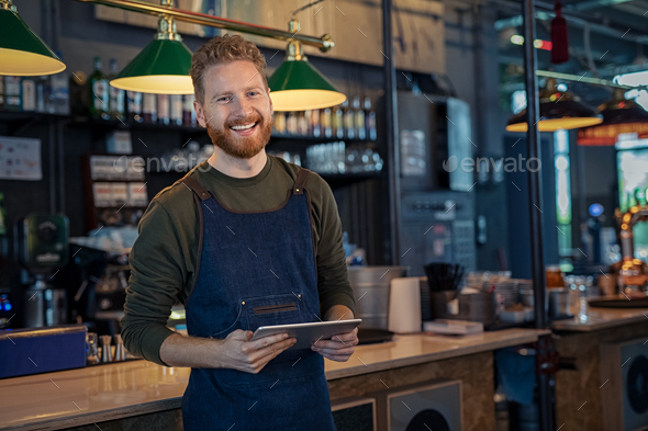 Smiling Waiter ready to take order at pub - Stock Photo - Images