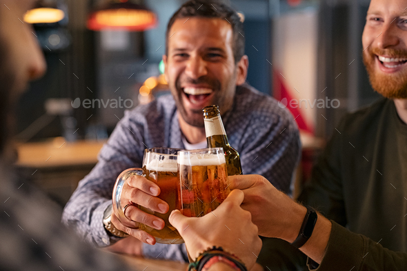 Friends toasting beer glass and bottle - Stock Photo - Images
