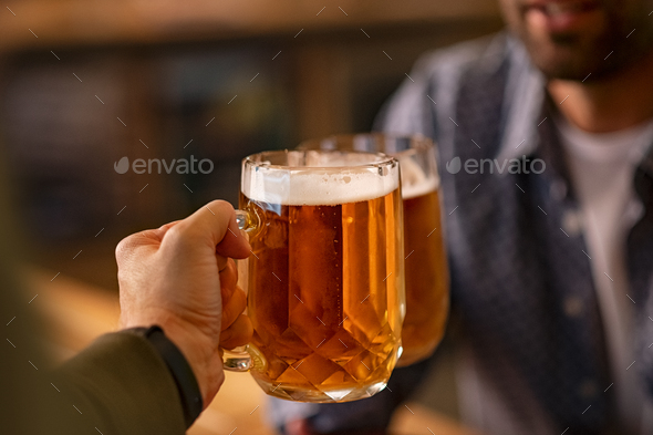 Toasting pint of beer glasses - Stock Photo - Images
