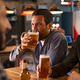 Man drinking draft beer with friends - PhotoDune Item for Sale