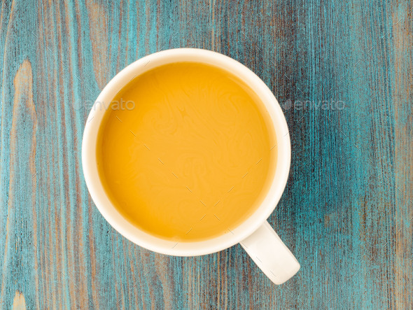 large white mug of tea with milk on a wooden blue background, a traditional English drink. - Stock Photo - Images