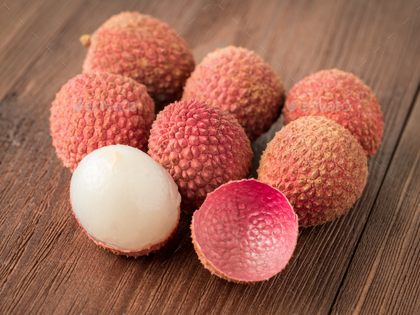 fresh ripe litchi fruit on a wooden table, macro, side view. - Stock Photo - Images
