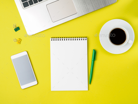 Top view of modern bright yellow office desktop - Stock Photo - Images