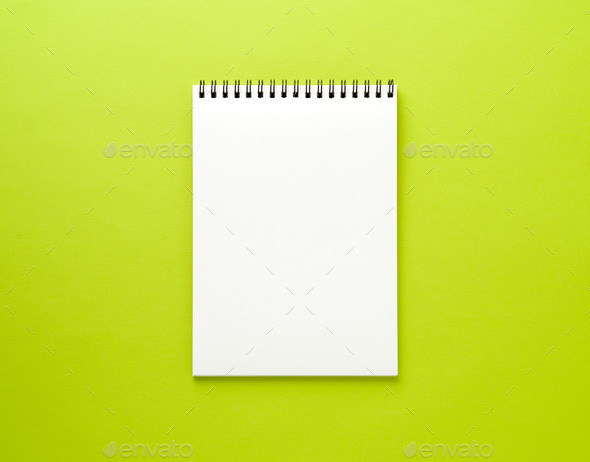 Blank notepad white page on green desk, color background. Top view,  empty space for text. - Stock Photo - Images