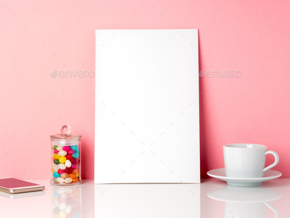 Blank white frame and candys in jar, cup - Stock Photo - Images
