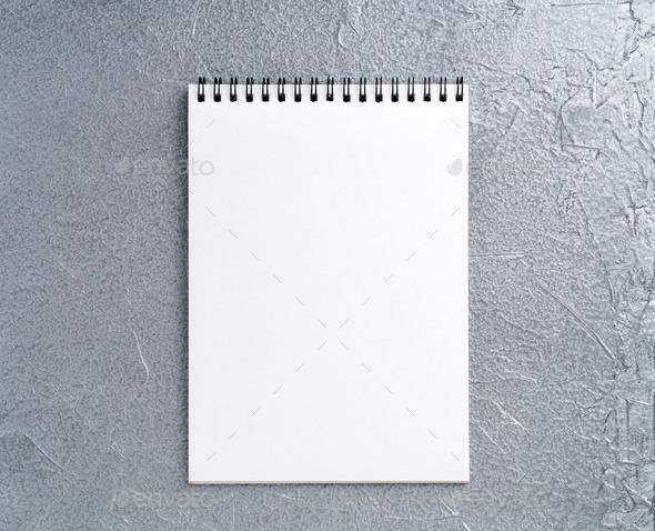 blank sheet of notebook with a spiral on a neutral gray textured silver metallic background - Stock Photo - Images