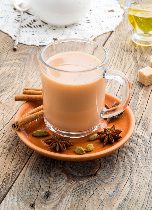 Masala Indian drink in the festival of Holi. Tea with milk and spices in a glass mug. - Stock Photo - Images