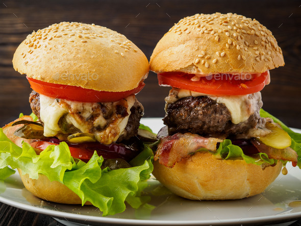 Two delicious homemade hamburgers with beef cutlet - Stock Photo - Images