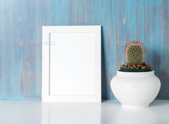 mock up frame on blue wooden wall - Stock Photo - Images
