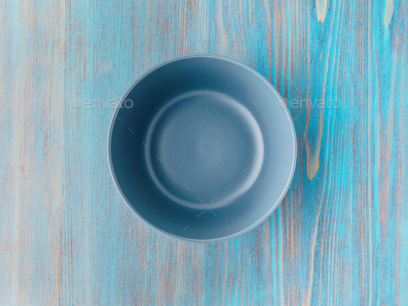 empty ceramic bowl for soup on the old wood turquoise table - Stock Photo - Images