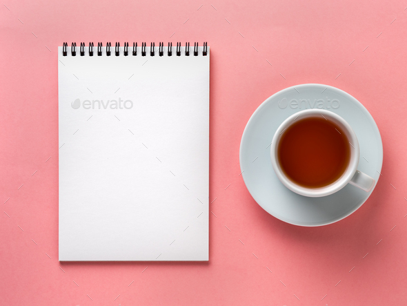 Blank notepad white page  and cup of tea on pink desk, color background. Top view,  flat lay. - Stock Photo - Images