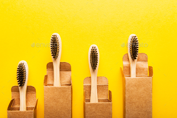 A family set of four wooden bamboo toothbrushes - Stock Photo - Images