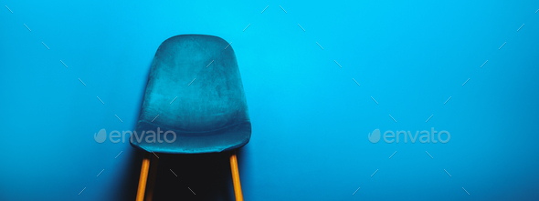 Modern Blue Velour Chair on wooden legs - Stock Photo - Images