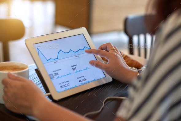 Analyzing business graph - Stock Photo - Images