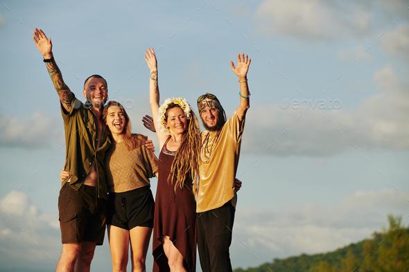 Joyful friends in sunset sun rays - Stock Photo - Images