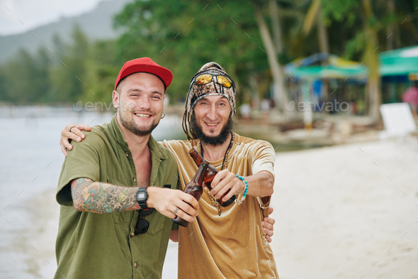 Friends drinking beer on beach - Stock Photo - Images