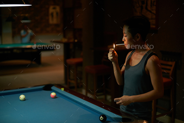 Smoking player - Stock Photo - Images
