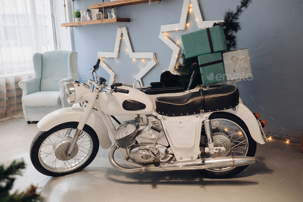 Cool retro motorcycle with Christmas presents. Motorcycle with gifts in decorated room - Stock Photo - Images
