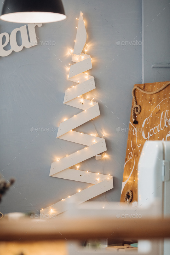 Beautiful white letters Happy New Year at blue wall in modern decoration studio - Stock Photo - Images