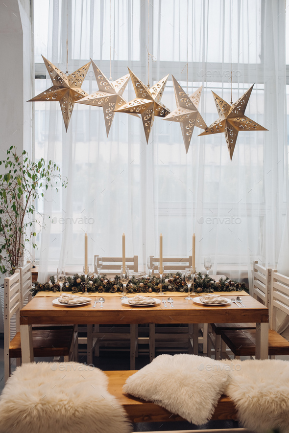 Dining table with decorative fir branches. Christmas holidays - Stock Photo - Images