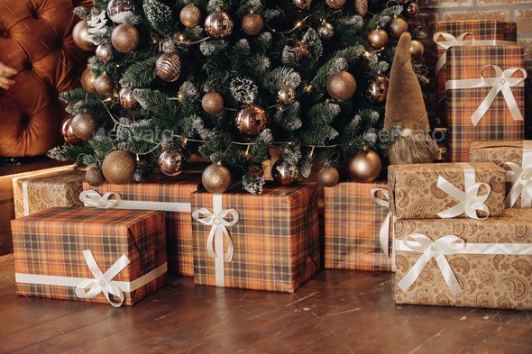 Wrapped Christmas presents under the tree. Christmas tree - Stock Photo - Images