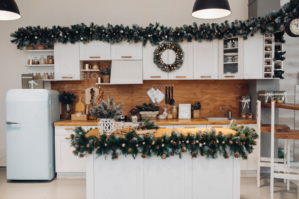 Beautiful white kitchen decorated for Christmas. Christmas holidays - Stock Photo - Images