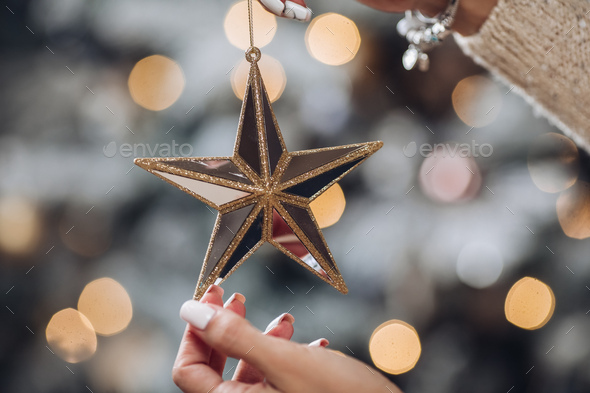 Female hands are holding a Christmas toy - Stock Photo - Images